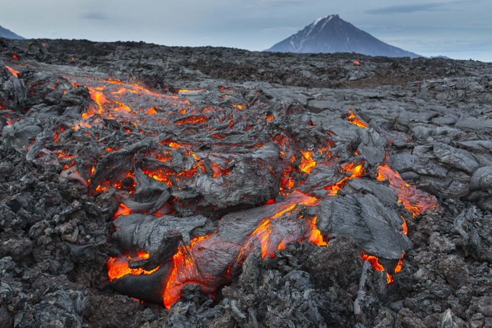 Hawaii on the Kamchatka Peninsula. Lava of pahoehoe on the background of the volcano Udine