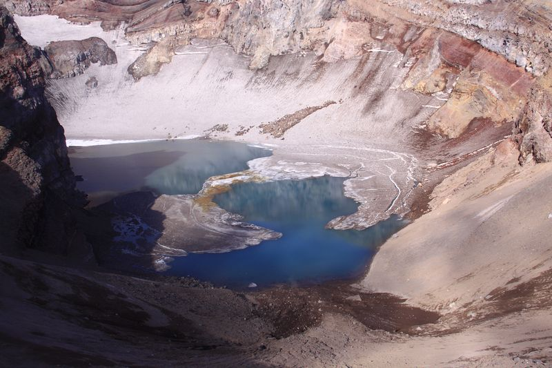An icy lake in one of the seven craters of Gorely volcano